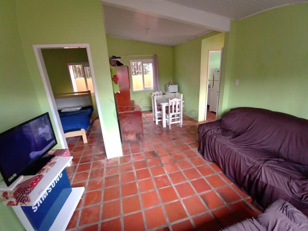 Comprar Casa / Padrão em Pelotas R$ 350.000,00 - Foto 1