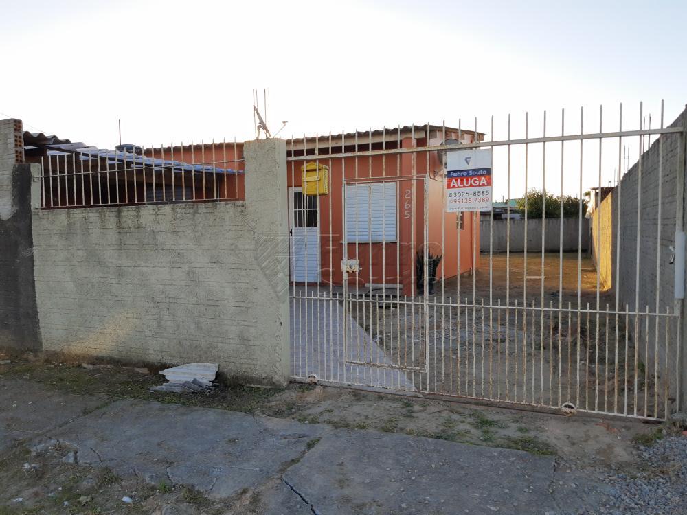 Alugar Casa / Padrão em Pelotas R$ 790,00 - Foto 1