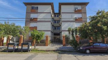 ÓTIMO APARTAMENTO ZONA NORTE, PRÓX AO BRILHANTE: 2 Dormitórios, sala, copa/cozinha, área de serviço, dependência completa, peças amplas, piso flutuante, box privativo, condomínio baixo, ensolarado e localização privilegiada em rua tranquila. Financiável. R$ 330.000,00 Negociáveis.